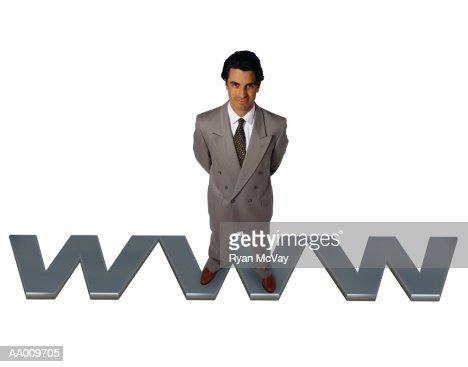 Businessman Standing on WWW : Stock-Foto