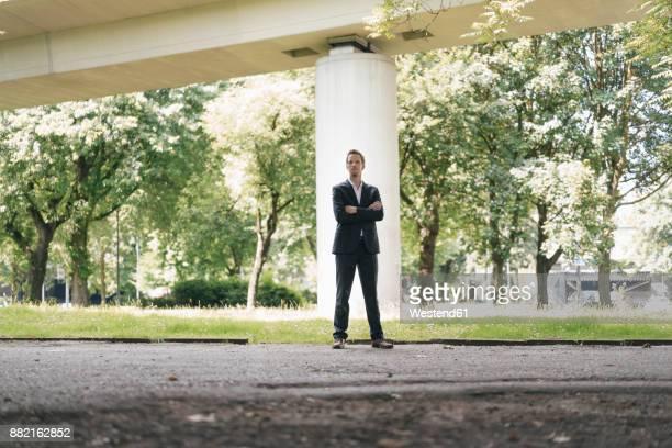 Businessman standing outdoors at a bridge
