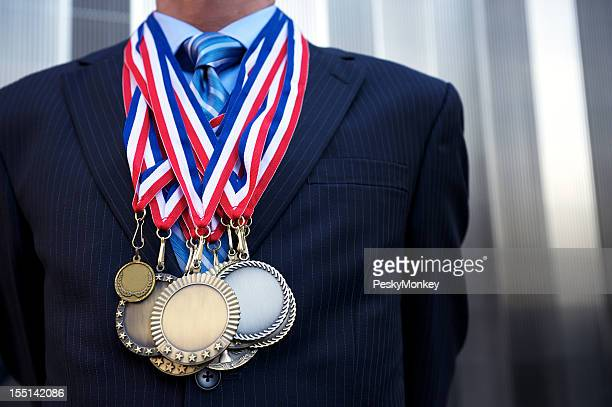 Businessman Standing Outdoors Decorated with Medals