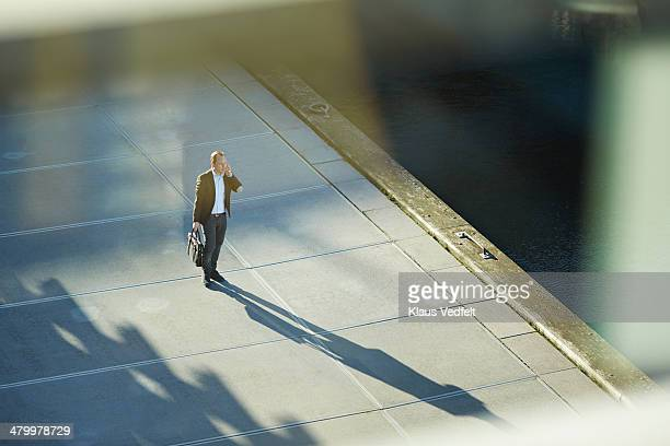 Businessman standing outside with phone