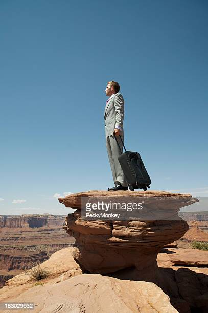 Businessman Standing Stranded on a Canyon Plateau
