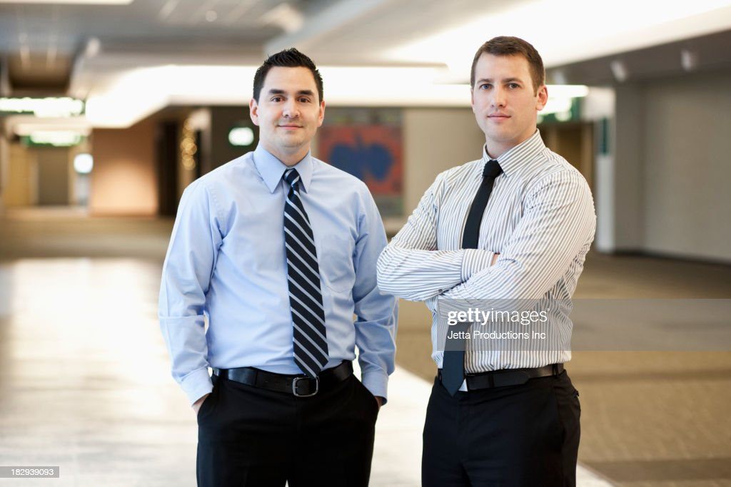 Businessman standing together in office