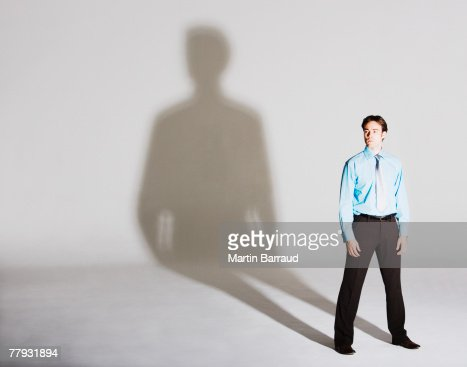 Businessman standing with arms by sides