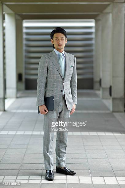 Businessman standing with digital tablet