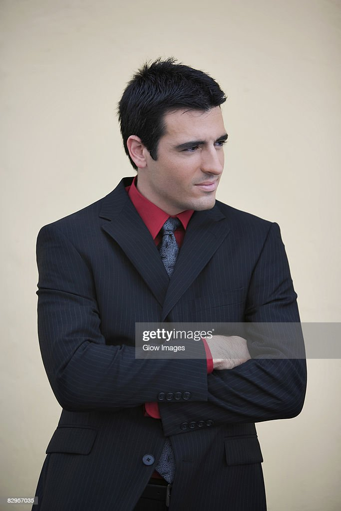Businessman standing with his arms crossed and smiling : Stock Photo