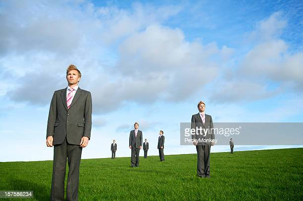 Businessman Stands Looking All Directions