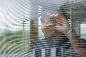 Businessman staring out office window