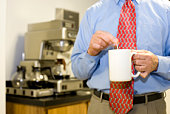 Businessman stirring coffee