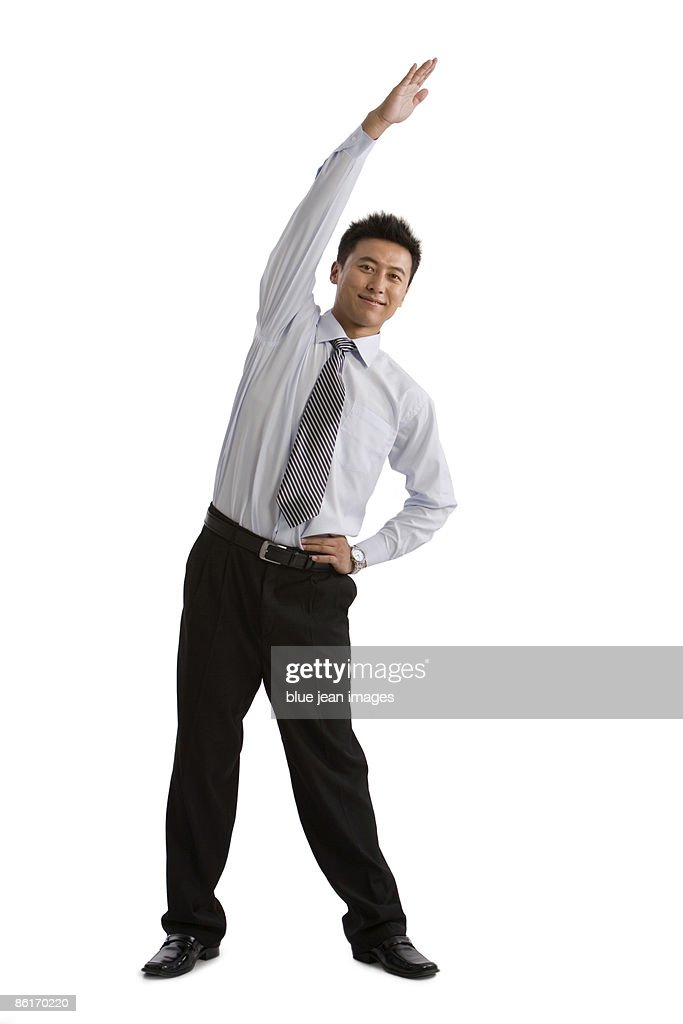 A businessman stretching