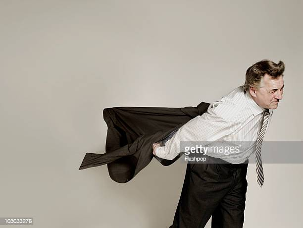 Businessman struggling in the wind