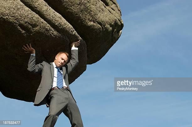 Businessman Struggling Lifting Massive Boulder Outdoors in Sky