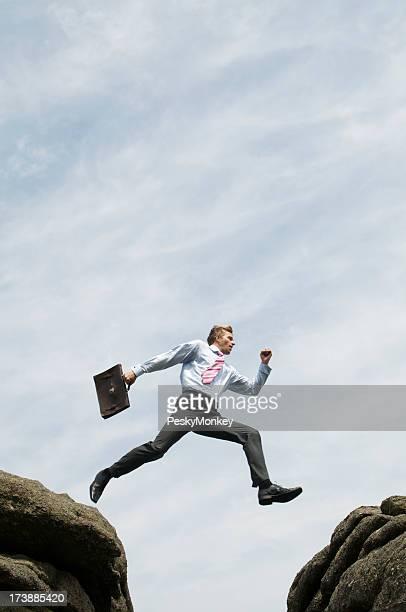 Businessman Takes a Confident Leap Across the Divide