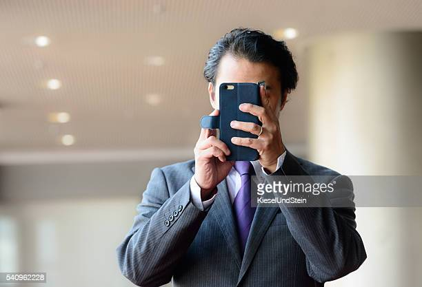 businessman takes a picture or selfie