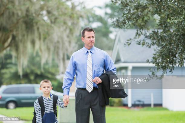 Businessman taking boy to school