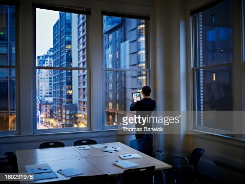 Businessman taking digital photo of cityscape : Stock Photo