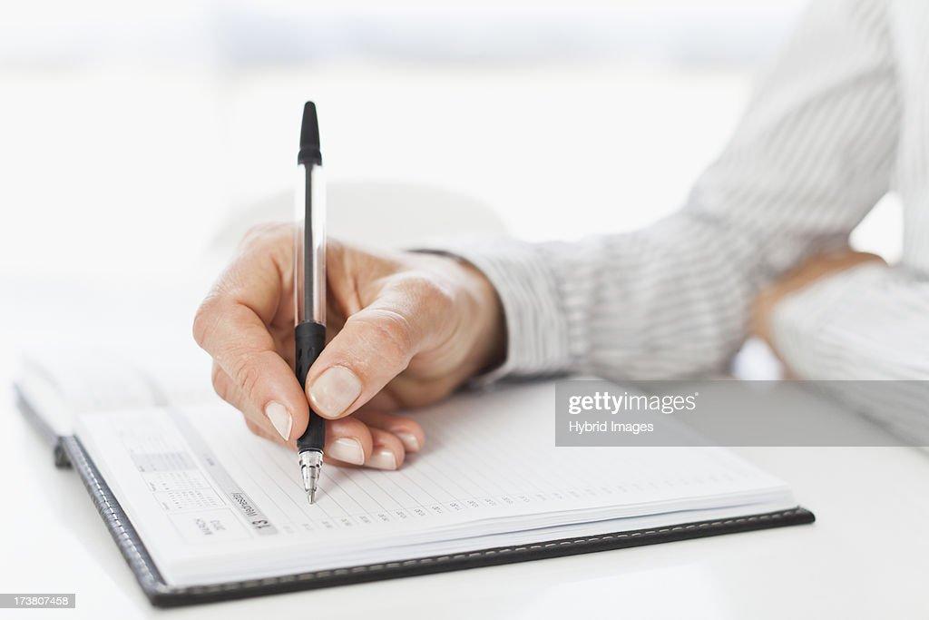 Businessman taking notes at desk