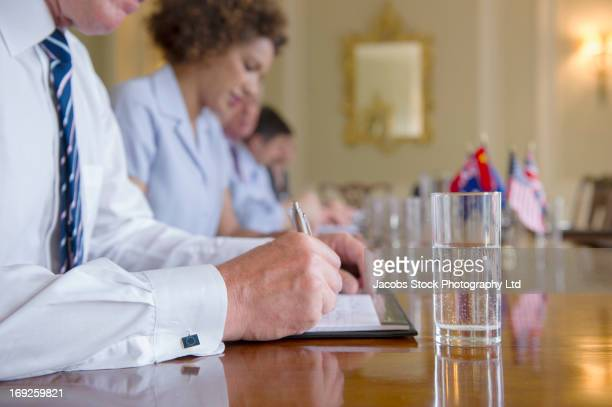 Businessman taking notes in meeting