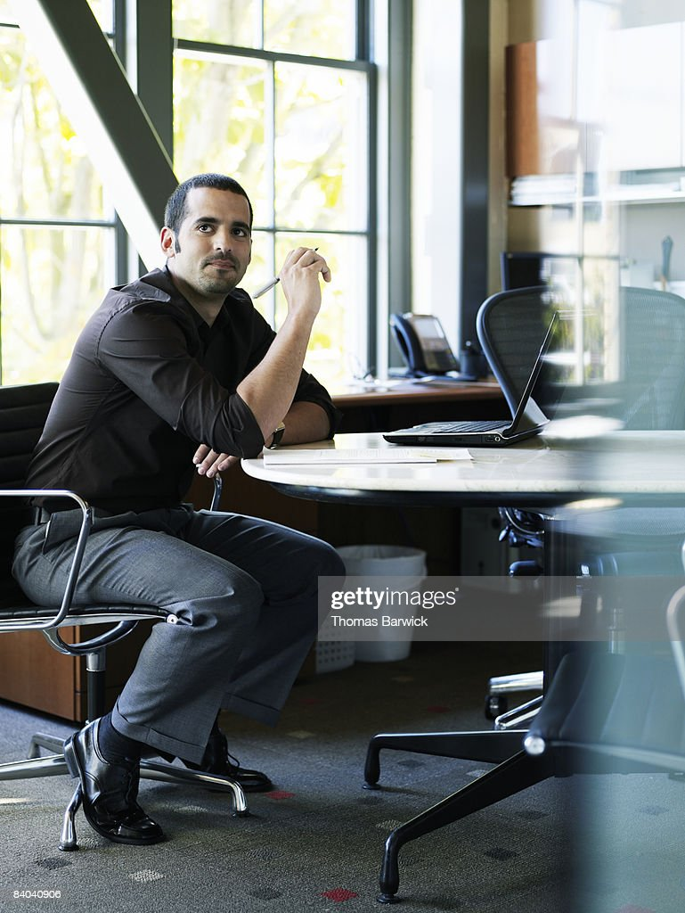 Businessman taking notes in office : Stock Photo