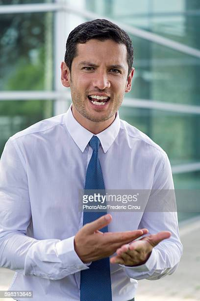 Businessman talking angrily