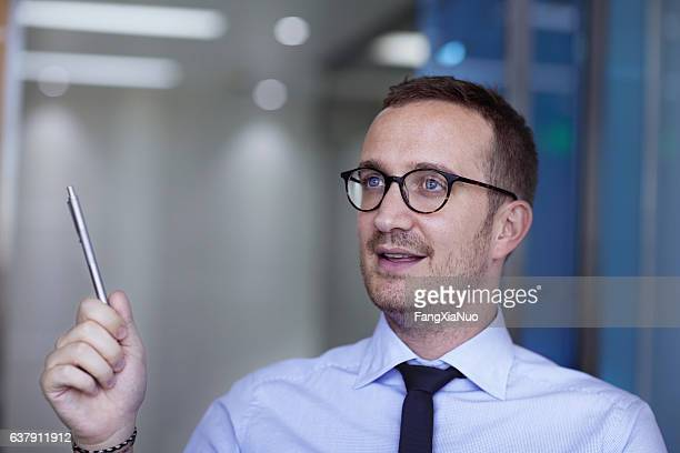 Businessman talking during meeting in office