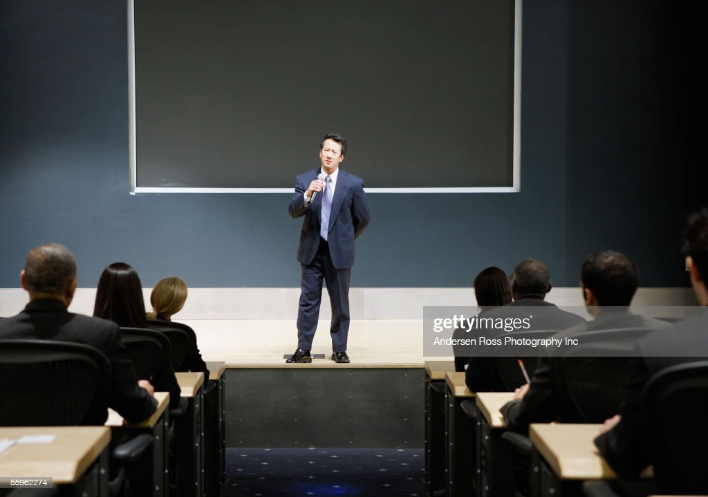 Businessman talking in auditorium : Stock Photo