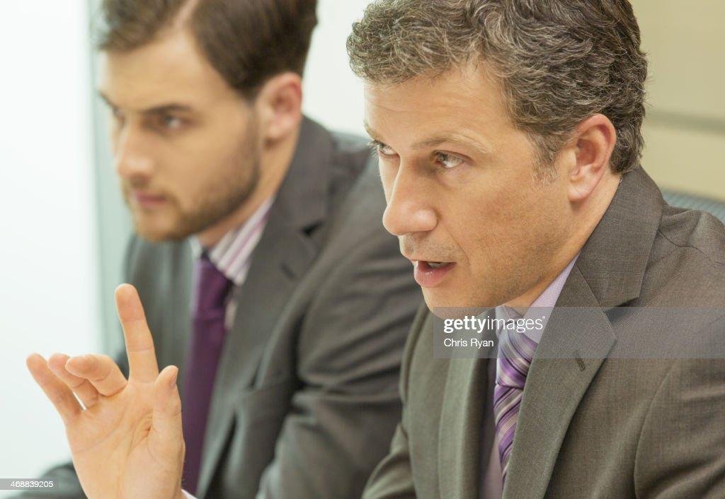 Businessman talking in meeting : Stock Photo