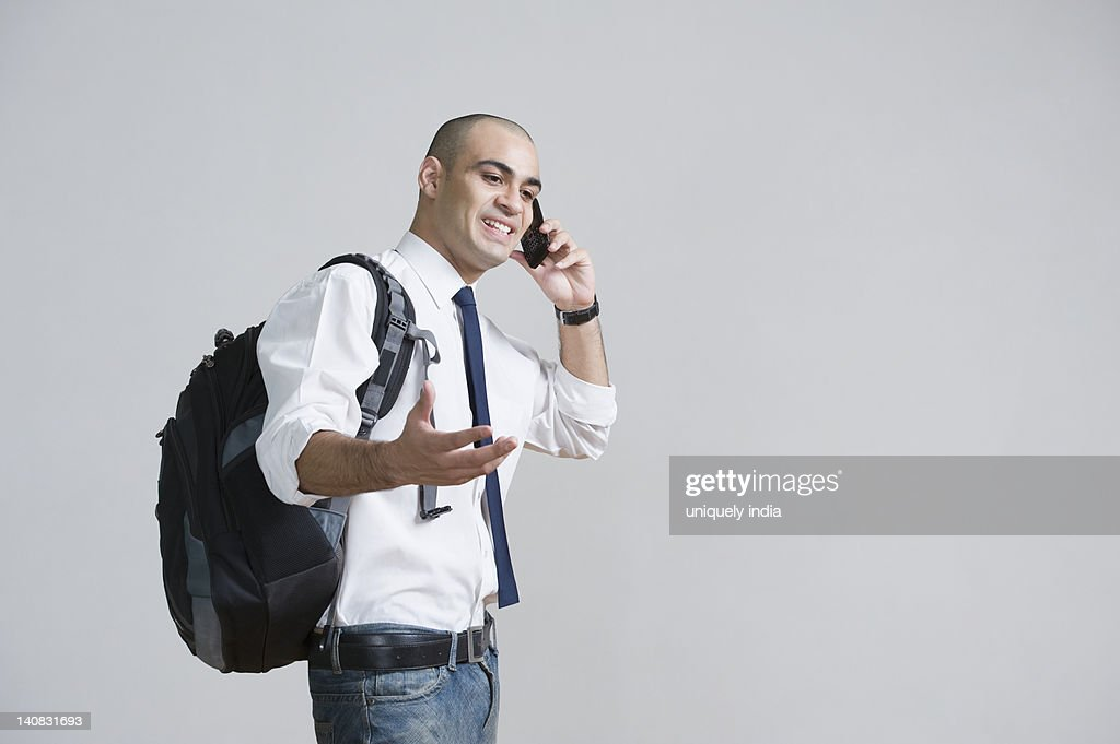 Businessman talking on a mobile phone : Stock Photo