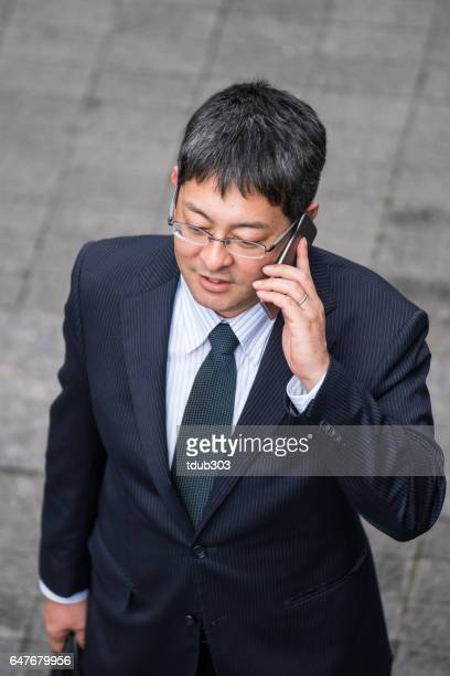 Businessman talking on a smartphone in the financial district