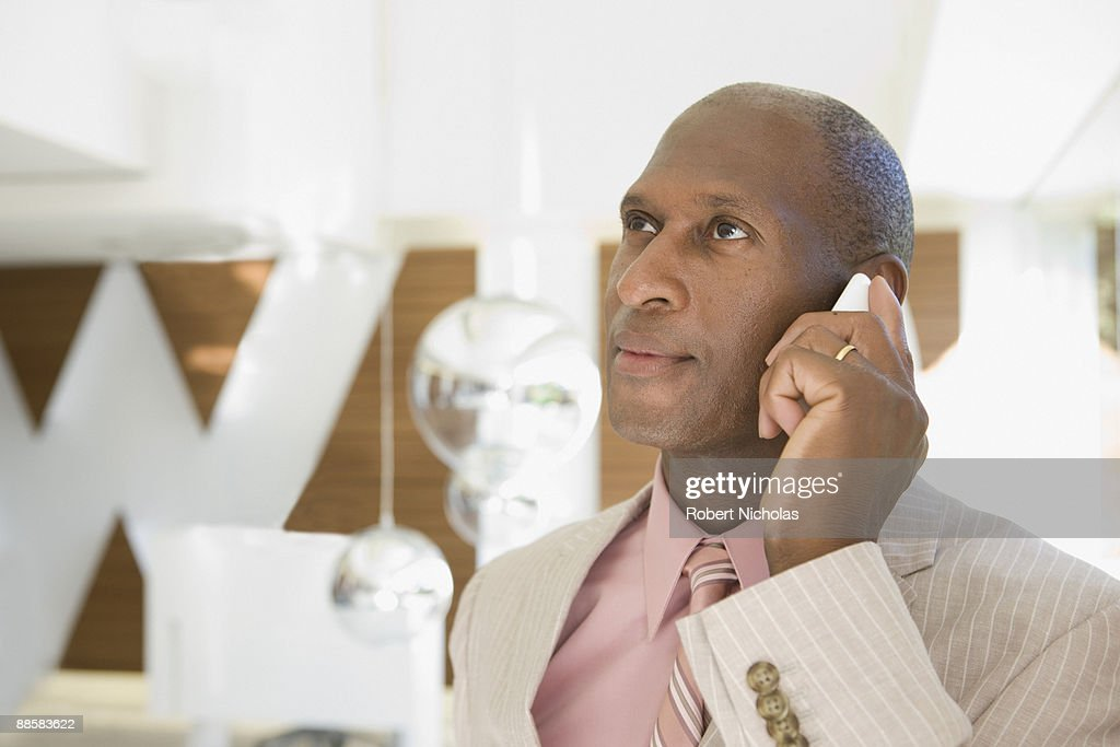 Businessman talking on cell phone : Stock Photo
