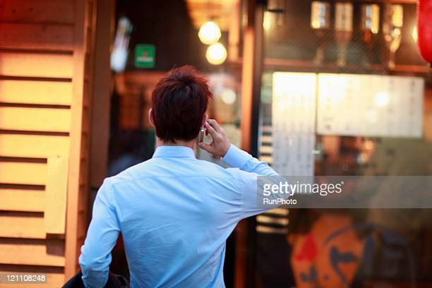 businessman talking on cell phone,night scene