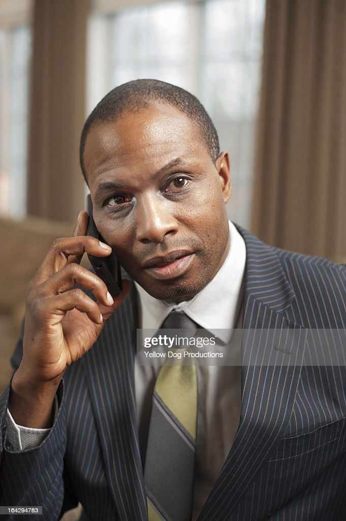 Businessman talking on his cell phone : Stock Photo