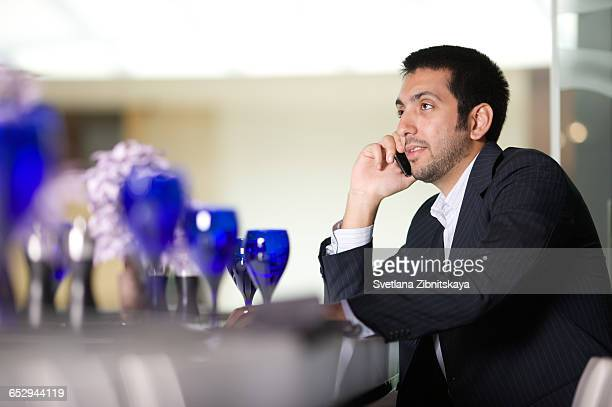 A businessman talking on his mobile.