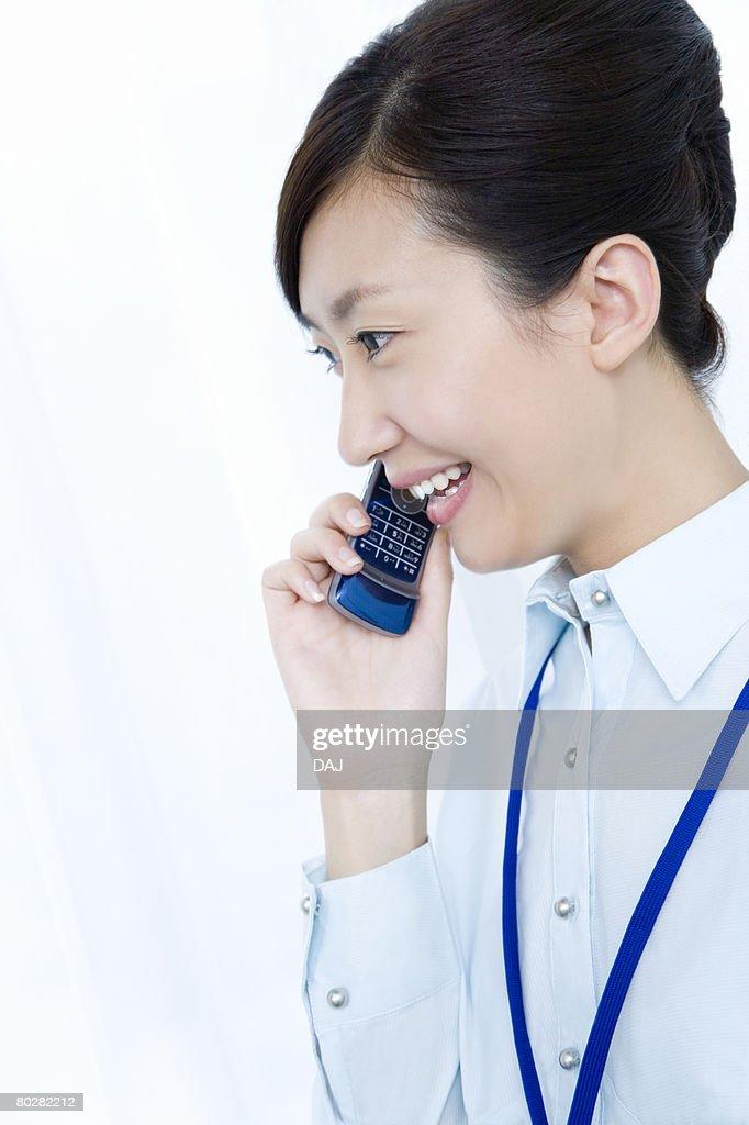 Businessman talking on mobile phone, smiling, China, Beijing : Stock Photo