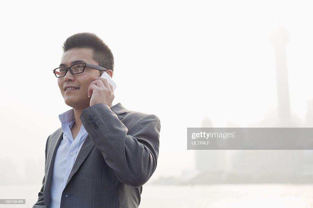 Businessman talking on smartphone : Stock Photo