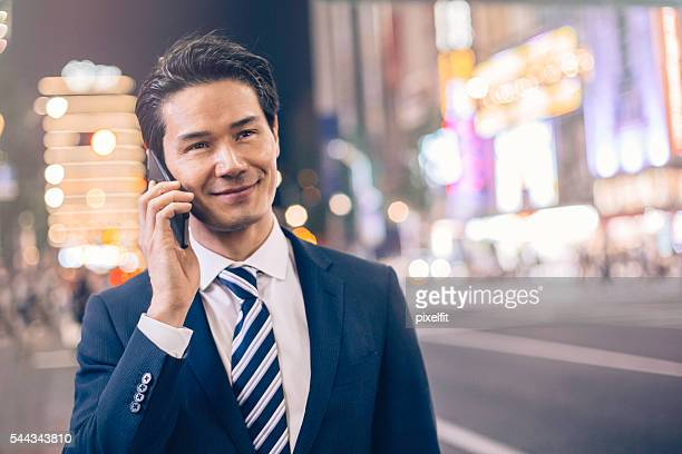 Businessman talking on the phone at night