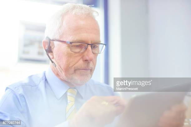 Businessman talking to client using headset