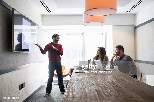 Businessman talking to colleagues in office meeting : Stock Photo