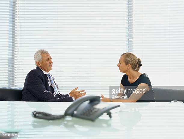 Businessman talking with a businesswoman in an office