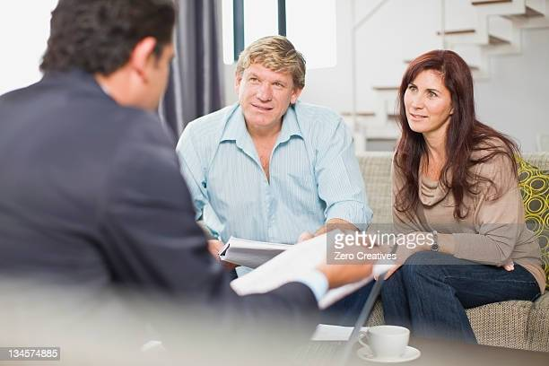 Businessman talking with couple