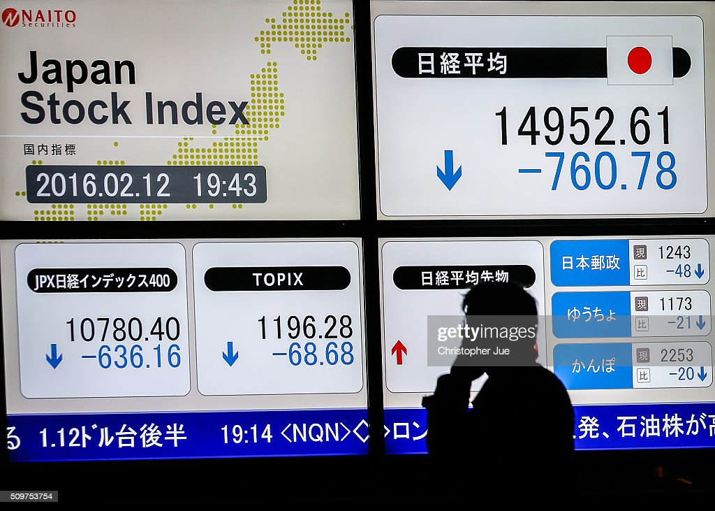 A businessman talks on his mobile phone in front of a stock market indicator board on February 12, 2016 in Tokyo, Japan. The Nikkei Stock Average finished 11% down for the week, its biggest weekly drop since October 2008, and the index for the day ended 4.8% down, the lowest since October 2014.