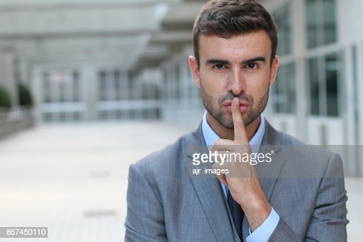 Businessman telling you to shut up : Stock Photo