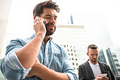 Businessman text messaging on the phone