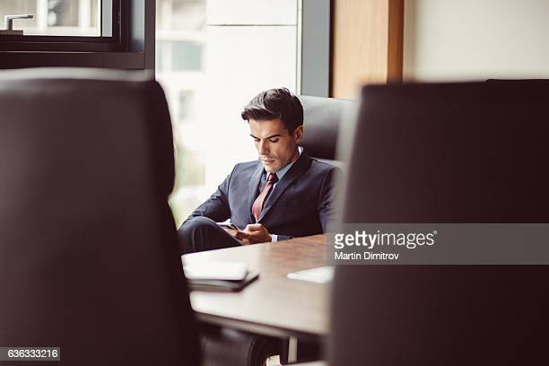Businessman texting in the office