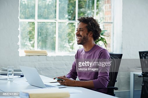 Businessman texting on the phone : Stock Photo