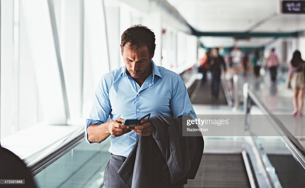 Businessman texting on the telephone