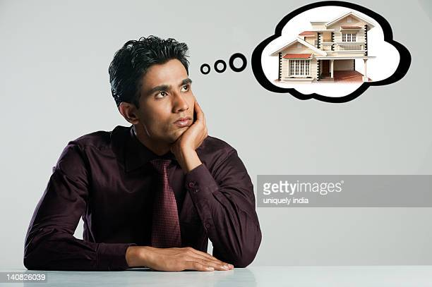 Businessman thinking about a home