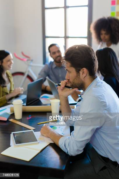 Businessman thinking during a meeting in office