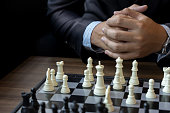 Businessman thinking how to play chess concept business strategy for win