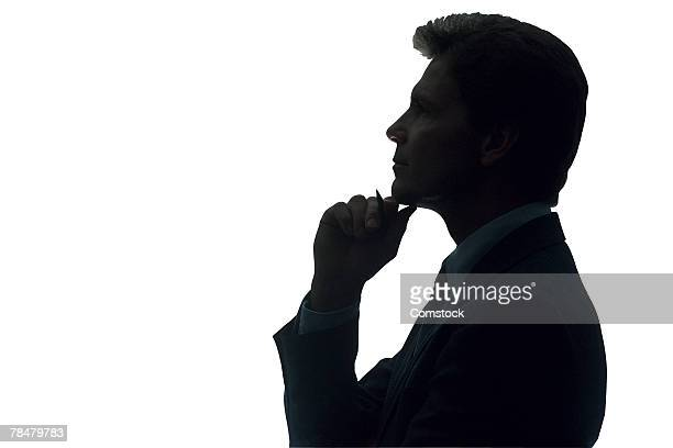 Businessman thinking in silhouette