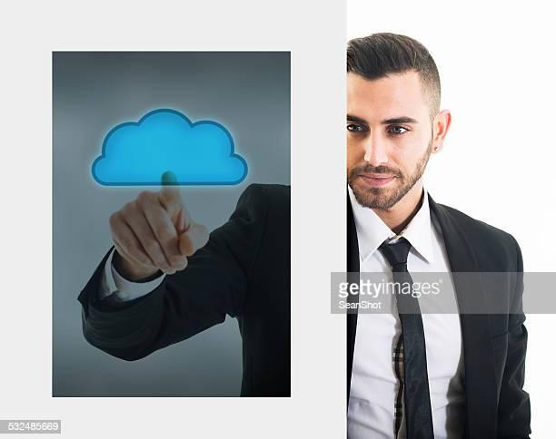 Businessman Through Touch Monitor Touching a Cloud